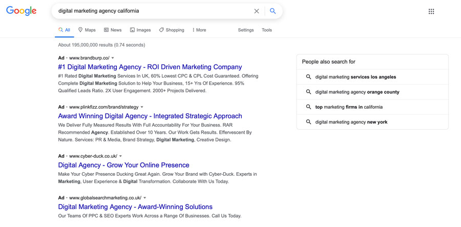 A screenshot of the Google SERPs showing a variety of digital marketing agency PPC ads
